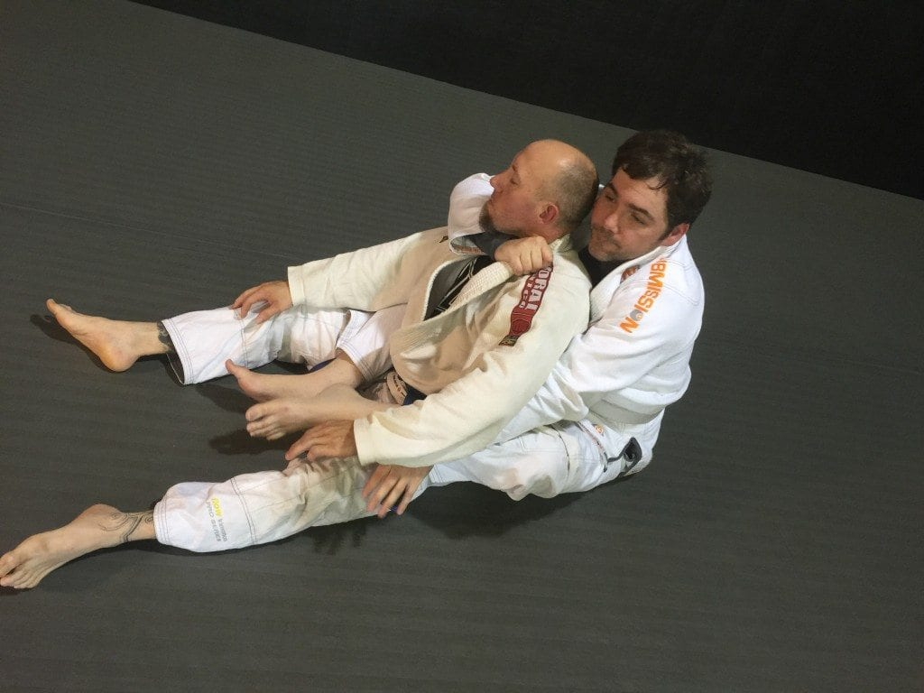 Seth and Paul from Leverage BJJ drilling bow and arrow chokes.