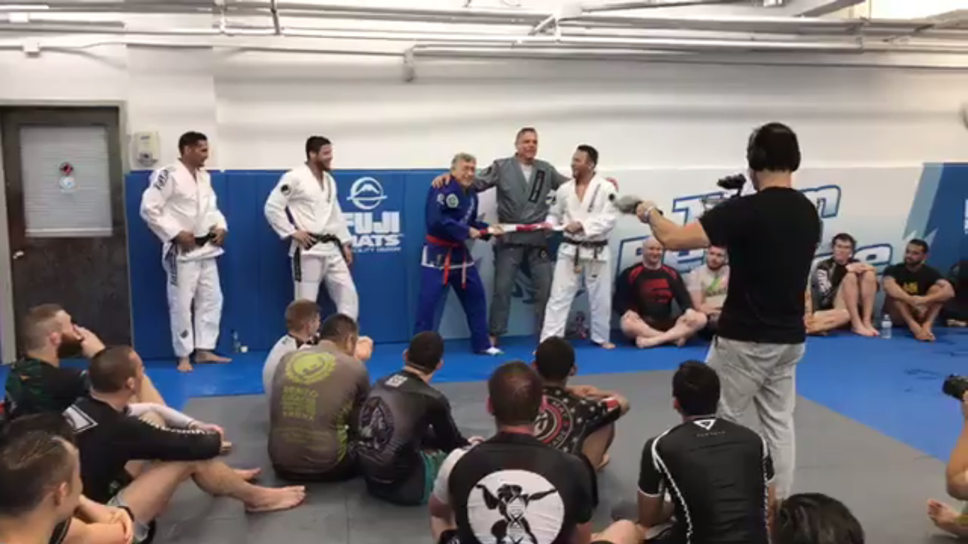 Renzo Gracie Gives Master Marcio Stambowsky His Red-And-White Coral Belt
