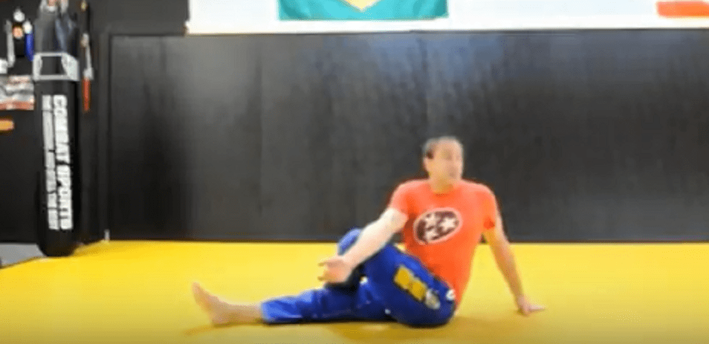 56-Year-Old Black Belt Demonstrates Stretches To Help Other